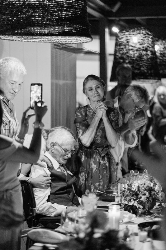Reception speech, a nod to the grandfather, mother of the bride clasping hands and teary